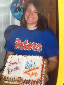 Kelsey From a Brave to a Gator cake decorated in high school colors and college colors
