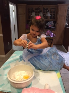 Cracking eggs...Her mom taught her well.